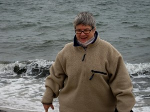 Carolyn Yoder beachcombing at Hardint's Beach at High Tide